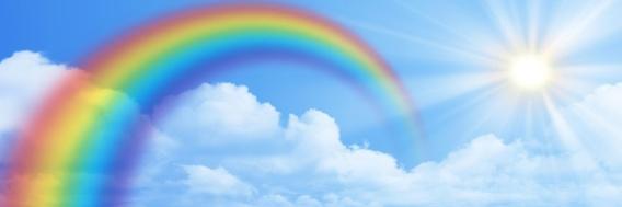 Rainbow on the blue sky banner