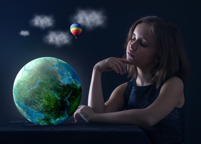 Teen girl with planet earth in his hands.